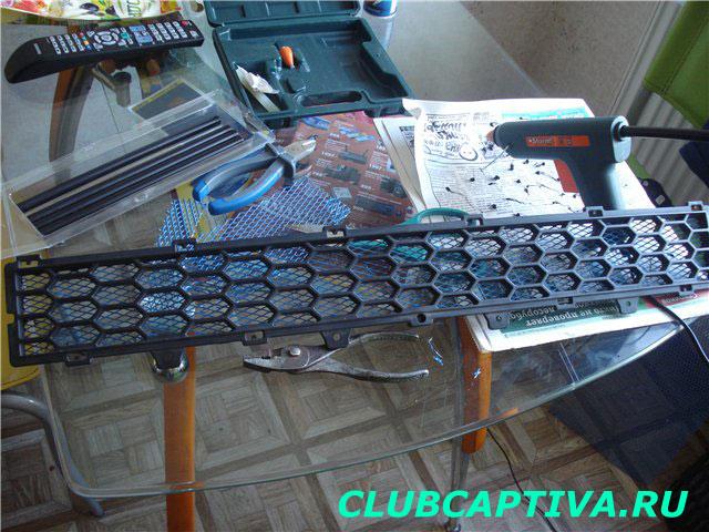 Центральная накладка бампера Chevrolet Captiva